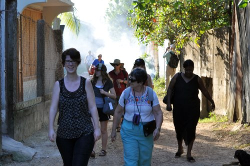The Horizons delegation walks through smokey streets.