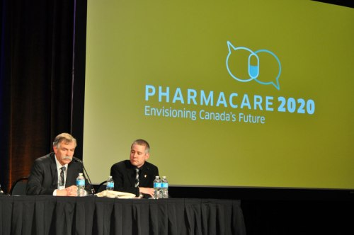 Jim Keon and Jody Shkrobot protect their turf during Pharmacare 2020 in Vancouver.