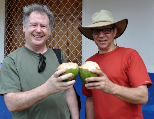 OPSEU's Rick Janson and Jeff Arbus toast with coconuts.