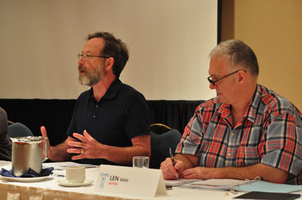 Michael McBane of the Canadian Health Coalition speaks to the Canadian Health Professionals Secretariat meeting Thursday. Seated next to him is NUPGE's Len Bush.