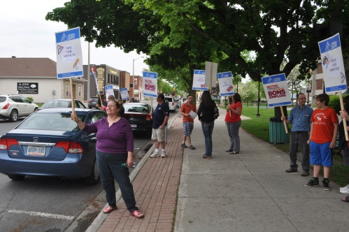 Protesting cuts to the Cornwall Community Hospital lab Monday night.