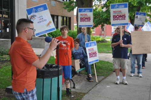 OPSEU Local 475 President Richard Meagher addresses the group gathered outside Cornwall City Hall.