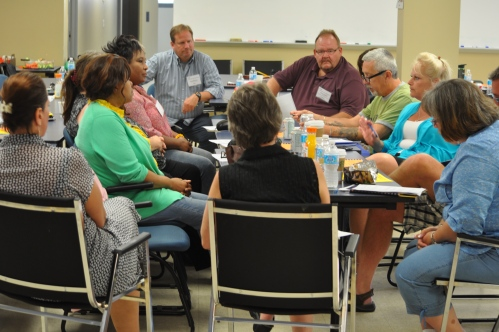 Photograph of one of three break-out groups speak about their experiences and search for best practices.