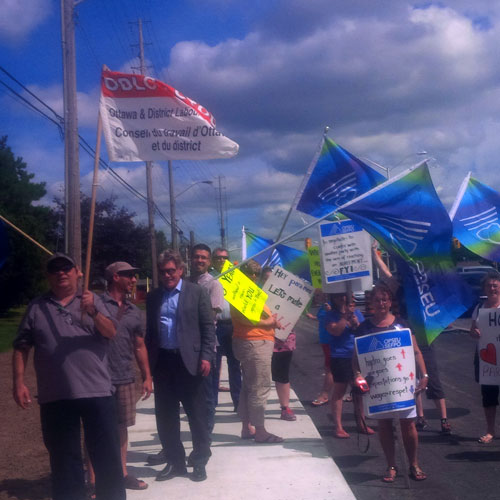 Photograph of demonstration outside of ParaMed's Ottawa offices. Support came from across the region as ParaMed's Renfrew workers travelled to Ottawa to picket the company's offices. The workers will almost certainly be on strike next Tuesday.