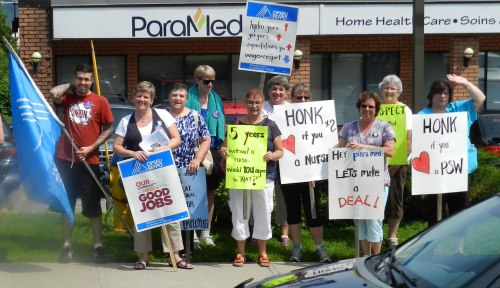 Photograph of ParaMed staff picketing outside of their Pembroke offices in July. 140 Renfrew County home care workers could be on strike as soon as September 2.