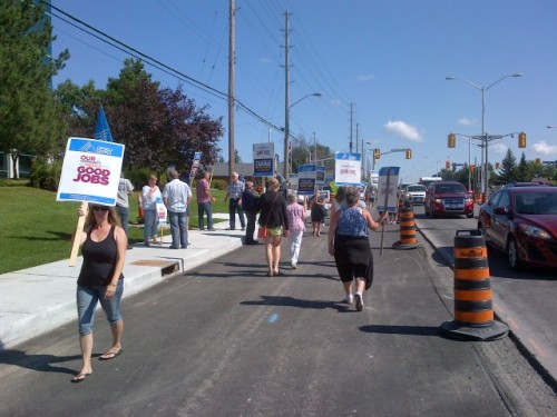 Photograph of striking Renfrew County home care workers and their supporters picket outside of ParaMed's Ottawa office on Monday.
