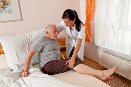 Picture of nurse helping a home care patient.