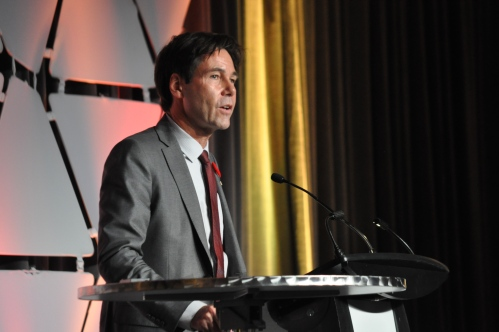 Photograph of Ontario Health Minister Dr. Eric Hoskins speaking at the Ontario Hospital Association annual conference.