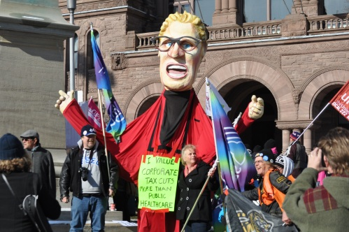 Photograph of large Kathleen Wynne puppet at the November rally against privatization of hospital services.