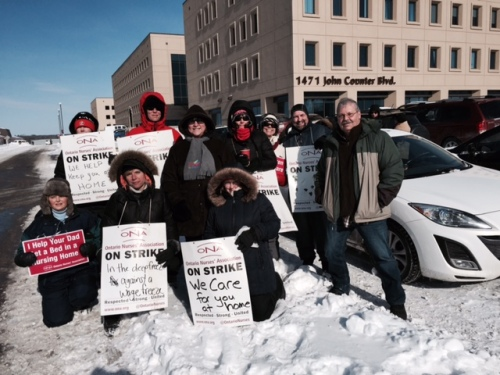Picture of OPSEU President Warren Smokey Thomas with striking ONA CCAC professionals in Kingston on Friday January 30.